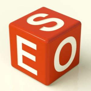 SEO letters on a die